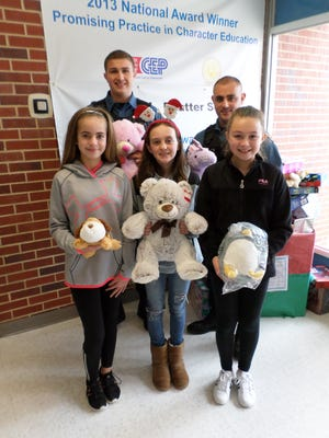 Caroline L. Reutter School's Student Council organized a stuffed animal collection in December. The stuffed animals were donated to the Township of Franklin Police Department, who will use them to comfort children involved in emergency situations.