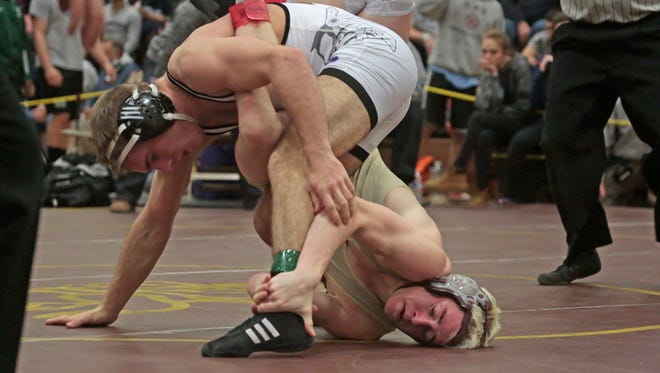 Arlington's Brady Robin (Gold) and John Jay's Conor Melbourne (White) compete 145 pound weight class in the Division 1 Championships at Clarkstown South in West Nyack on Feb. 14, 2016.
