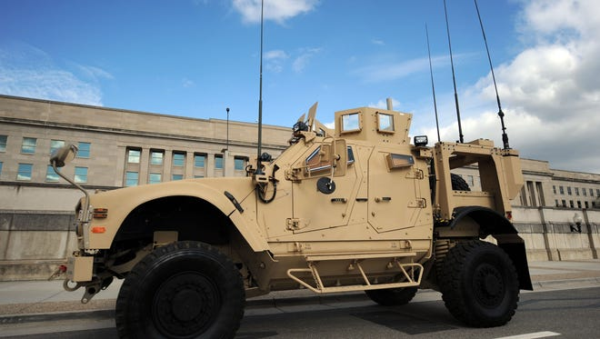 A new Mine Resistant Ambush Protected (MRAP) vehicle called the M-ATV is on display outside the Pentagon on Nov. 2, 2009, in Washington. The M-ATV is designed to replace the up-armored Humvee in Afghanistan.