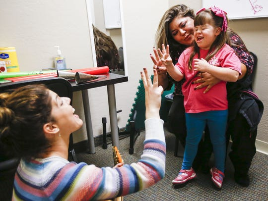 Byanca Carrasco is helped by her mother, Ramona, during