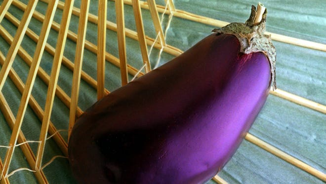 Beneath the shiny, purple-black skin of egglplant is a pale whitish-green flesh with a mild flavor that often wins over skeptics. When picking one at the market look for a dark, shiny unbruised eggplant with a fresh, green stem end.