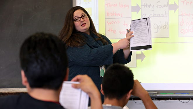 Leave-replacement teacher Erin Mark teaches a Level 2 ESL reading class at Ossining High School on Jan. 22.