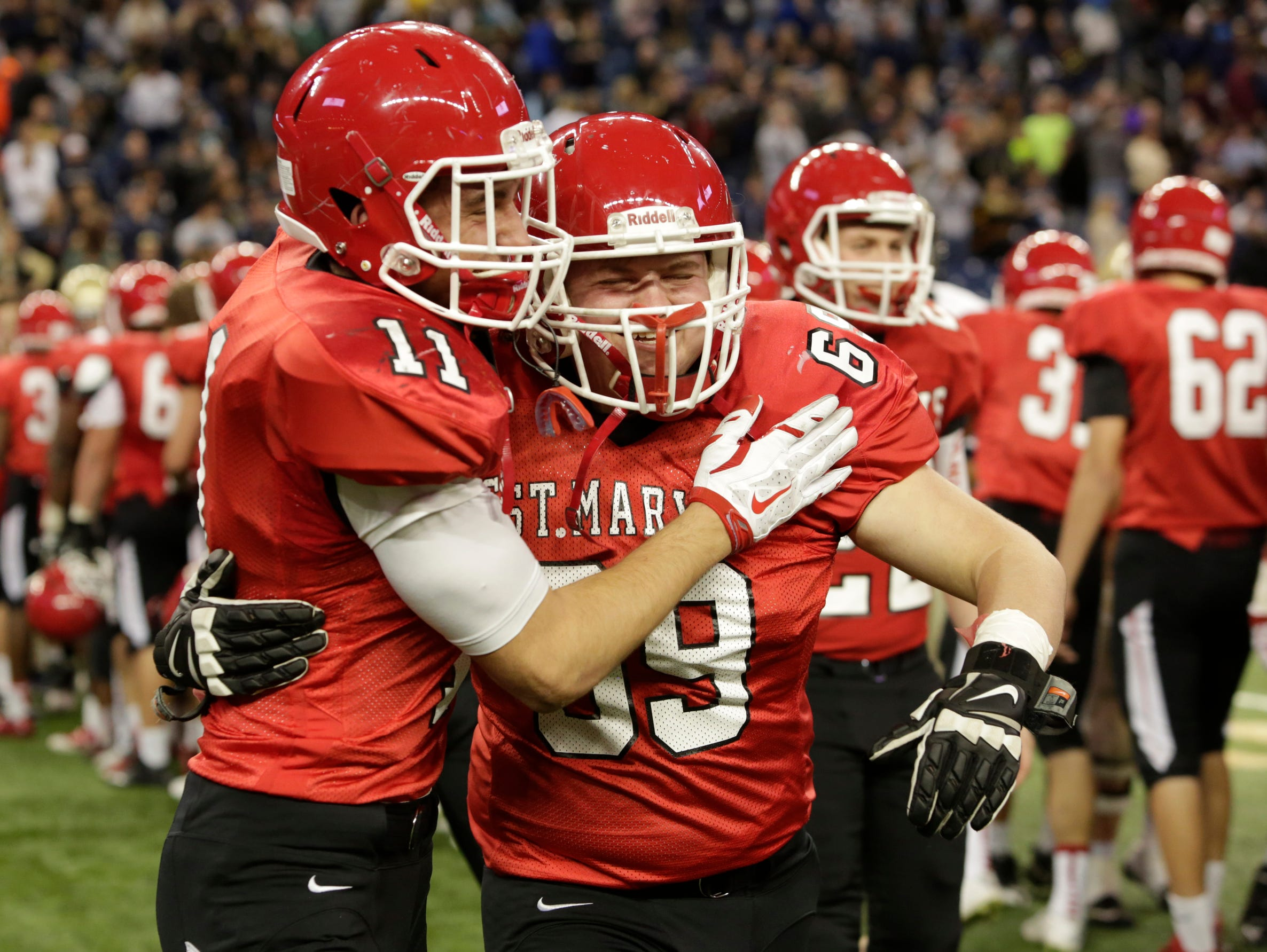 Orchard Lake St. Mary's Tyler Cochran, left, and John Mike Santoni celebrate their 29-12 victory over Chelsea in the Division 3 football title game at Ford Field on Saturday.