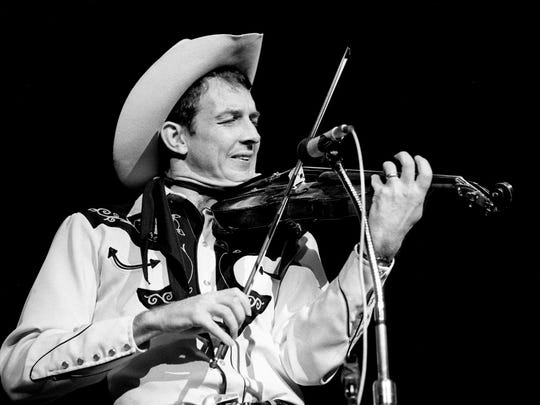 """Woody Paul of the Riders in the Sky performs during the taping of the """"Hee Haw"""" TV special saluting the Grand Ole Opry birthday celebration at the Opry House on Oct. 8, 1987. """"The Mystical Unknowns of Cornfield Country Salute the Grand Ole Opry"""" taping kicked off Country Music Week festivities."""