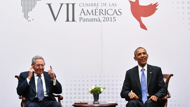 Cuban President Raul Castro gestures in response to a reporter's question during a meeting with President Obama on the sidelines of the Summit of the Americas on April 11, 2015, in Panama City.