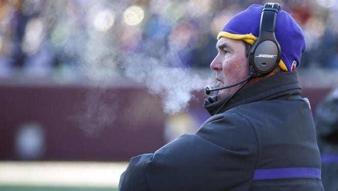 Minnesota Vikings head coach Mike Zimmer watches from the sideline during the second half of Sunday's wild-card game against the Seattle Seahawks in Minneapolis.