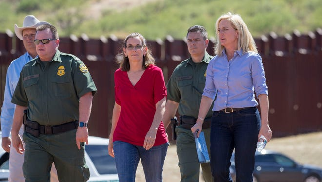 RRep. Martha McSally (R-Ariz) welcomes Department of Homeland Security Secretary Kirstjen Nielsen at the U.S./Mexico border fence near Hudgins Plateau and Smuggler's Gulch in Nogales, Ariz. on May 31, 2018.