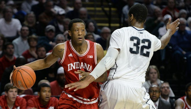 Troy Williams (left) scored 11 points Saturday, a career high in Big Ten play. But that wasn't enough to push the Hoosiers past Minnesota, as IU was outscored by 12 in the second half.