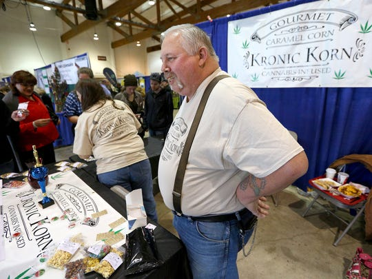 Mike Morlock, of Salem, talks about his business Kronic Korn, that is a cannabis infused caramel corn, during The Hemp and Cannabis Fair, Sunday, November 15, 2015, at the Oregon State Fairgrounds in Salem, Ore.