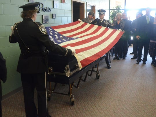 The Battle Creek Police Department Honor Guard drapes