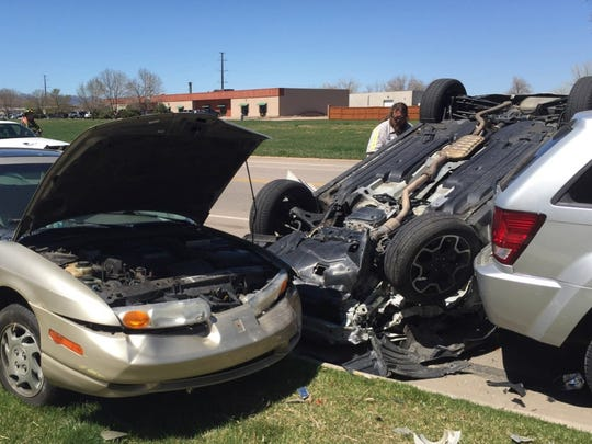 A Subaru Crosstrek ended up on its roof Thursday afternoon in north Fort Collins after smashing into a parked Saturn and then rolling into another vehicle. Nobody was seriously injured.