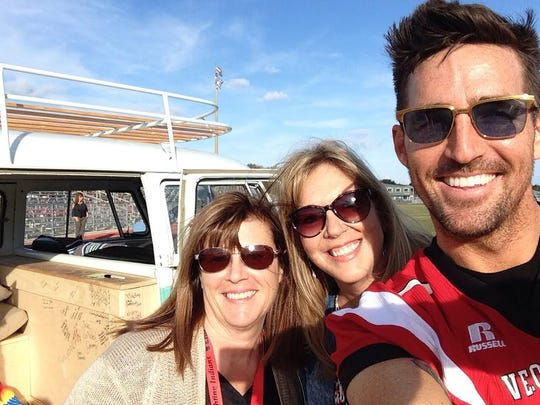 Country star Jake Owen poses for selfies at Vero Beach High School with Dawn Bradford and Toni Kouns.