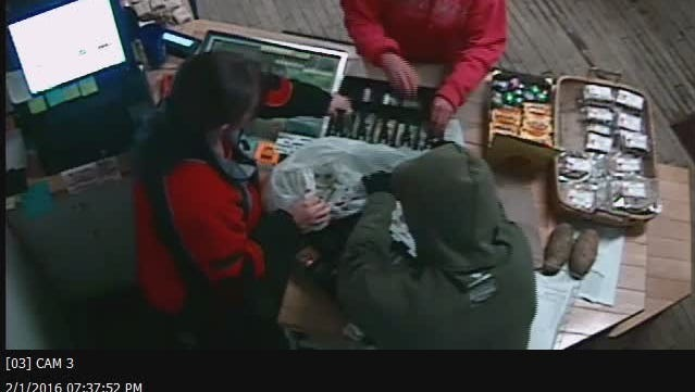 Vermont State Police released this photo from surveillance footage at Cabot Village Store. Police say the man in the green sweatshirt is a suspect in an armed robbery.