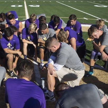 Notre Dame Preparatory High School football coach Mark