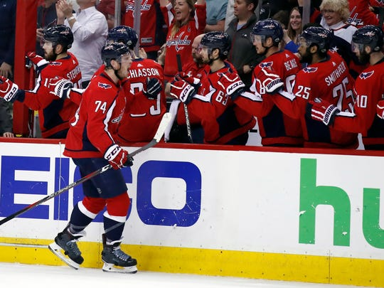 Washington Capitals defenseman John Carlson (74) celebrates his goal during the first period of Game 5 in the second round of the NHL Stanley Cup hockey playoffs against the Pittsburgh Penguins, Saturday, May 5, 2018, in Washington. (AP Photo/Alex Brandon)