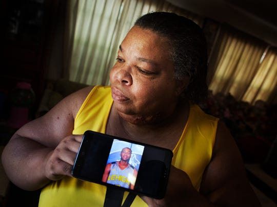Stephanie White holds a photo of her deceased son,