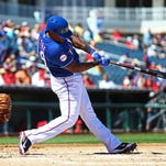 Texas Rangers designated hitter Adrian Beltre bats against the Los Angeles Angels in a spring training game at Surprise Stadium.
