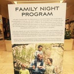 Signage promoting the Lansing Mall's Family Night Program just inside the mall entrance.