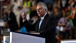 Virginia Gov. Terry McAuliffe takes the stage during