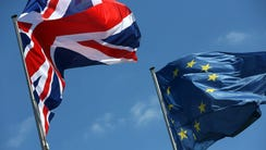 A British Union Jack (L) and European Union flag fly