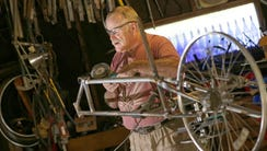 A.D. Carson, owner of Recycled Recumbents,  builds