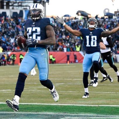 Titans running back Derrick Henry (22) scores on a