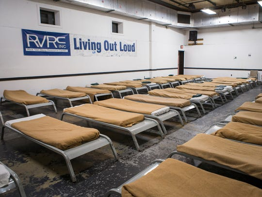 Beds fill the men's section of the Rick VanStory Resource Center in Wilmington.