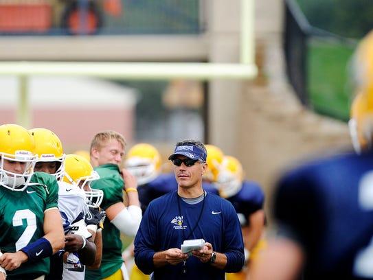 Augustana coach Jerry Olszewski, center, during a practice