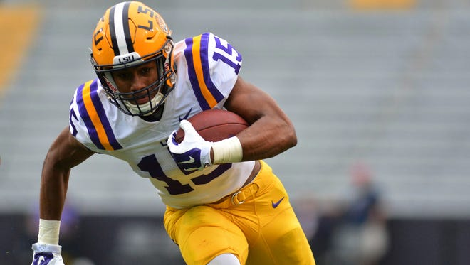 LSU Tigers wide receiver Malachi Dupre (15) runs with the football during the Spring Game at Tiger Stadium.