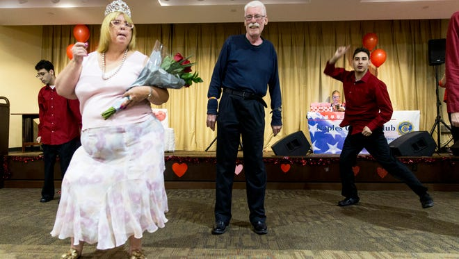 Crowned queen Stephanie Paris, left, and crowned king David Franco, right, dance together along with Bruce Irvin during the 28th Annual Valentine's Dinner Dance at Emmanuel Lutheran Church in Naples, Florida on Friday, Feb. 10, 2017. Naples Civitan Club hosts the event for members of the Foundation for the Developmentally Disabled.
