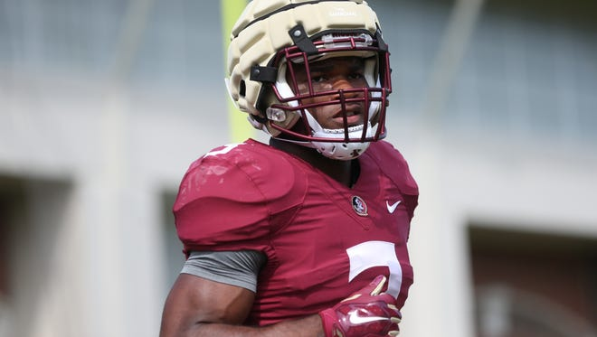 FSU's Cam Akers works out during spring practice at the Dunlap Training Facility on Thursday, March 30, 2017.