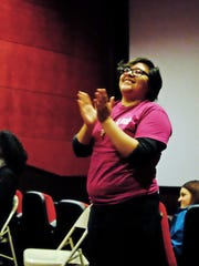 Moderator Miranda Mossey applauds an audience member's comments at the LatinX L.G.B.T.Q Film Festival at the Maya Cinema in Salinas.
