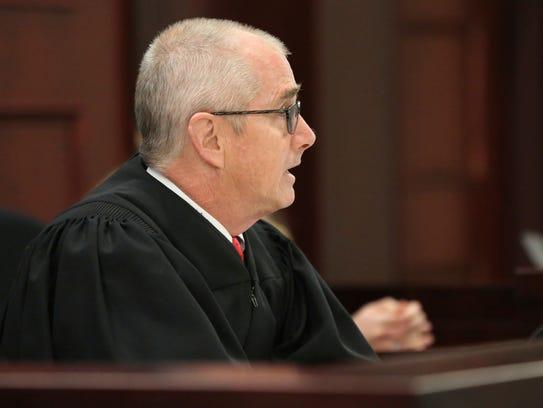 Judge Robert Turk asks defendant David Eisenhauer during
