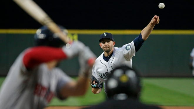 Seattle Mariners starting pitcher James Paxton pitches to Boston Red Sox's Deven Marrero in the fifth inning of a baseball game, Monday, July 24, 2017, in Seattle. (AP Photo/Ted S. Warren)