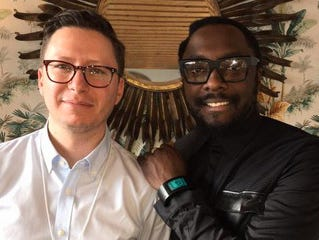 USA TODAY's Kim Hjelmgaard, left, with musician and entrepreneur will.i.am. at Davos, Switzerland, on Jan. 22, 2015.