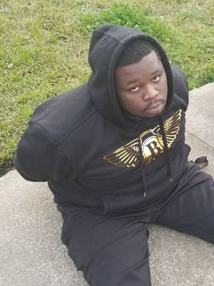 Mark Anthony Hill is shown at the time of his Tuesday arrest in Sacramento.
