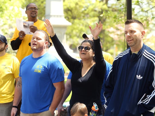 Participants sing 'This is Amazing Grace' during the Annual National Day of Prayer event on the Morristown Green..  May 3, 2017, Morristown, NJ