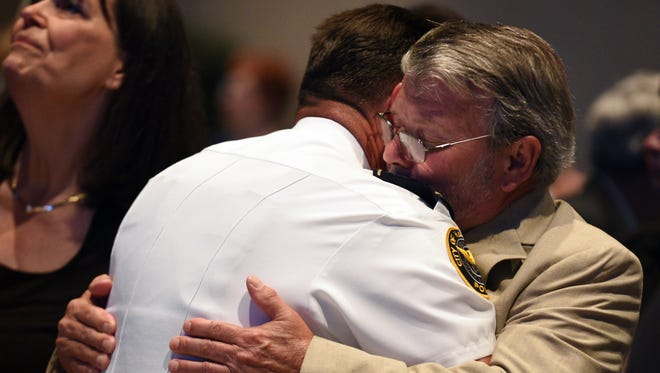 Dan Deen is hugged as his son, Benjamin Deen, was honored Monday at a memorial service at Lake Terrace Convention Center. Benjamin Deen and fellow officer Liquori Tate lost their lives Saturday while serving the Hattiesburg Police Department.