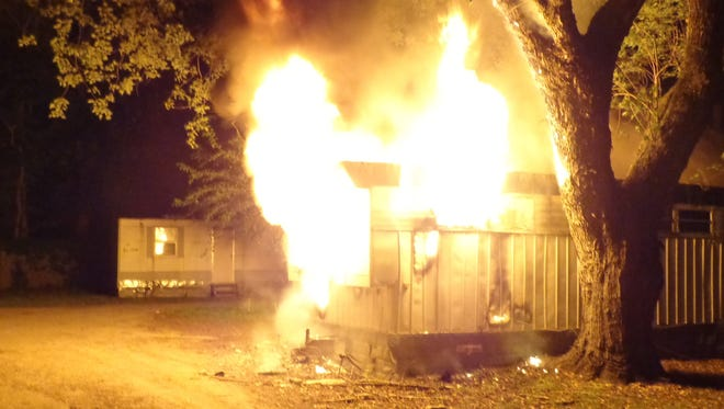 Firefighter get ready to battle this mobile home fire on Warwick Lane near Princess Anne early Wednesday morning.