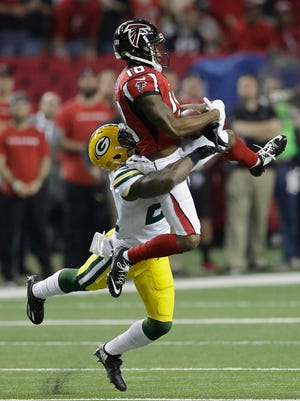 Atlanta Falcons' Taylor Gabriel catches a pass in front of Green Bay Packers' Quinten Rollins during the first half of the NFC championship game Sunday, Jan. 22, 2017, in Atlanta.