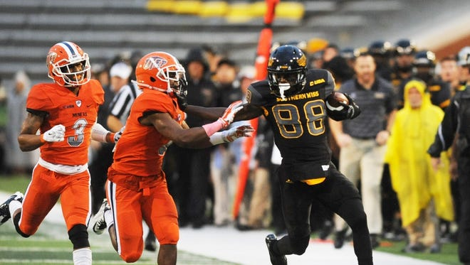 Southern Mississippi wide receiver Mike Thomas runs the ball past the University of Texas at El Paso defense during an NCAA college football game Saturday, Oct. 31, 2015, in Hattiesburg, Miss.