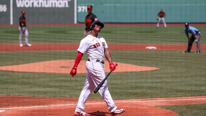 Red Sox third baseman Rafael Devers reacts after striking out against Orioles starting pitcher Alex Cobb during the first inning Saturday.