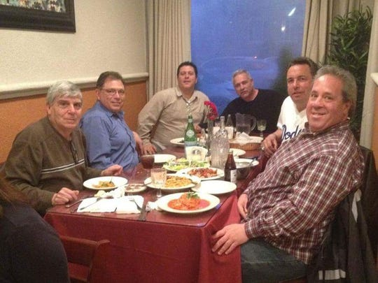 The late George Zanfini (left) with friends at a dinner
