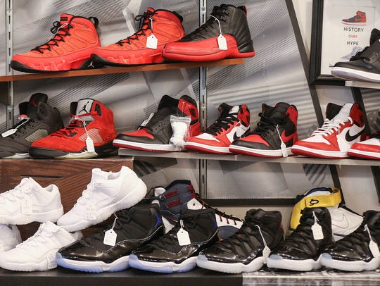 Collector shoes are seen behind the counter at Grails