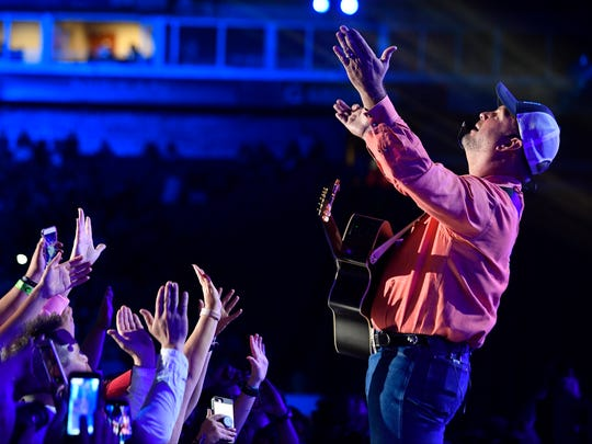 Garth Brooks performs a surprise set on the first day