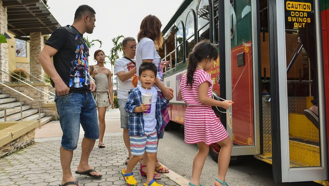 In this file photo, tourists board the Tumon Shuttle. Tourist Attraction Fund revenues grew from $37 million in fiscal 2015 to $40.9 million in fiscal 2016.