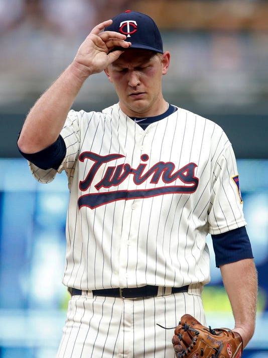 Minnesota Twins pitcher Tyler Duffey adjusts his cap after giving up a two-run home run to Atlanta Braves' Jeff Francoeur during the first inning of a baseball game Wednesday, July 27, 2016, in Minneapolis. (AP Photo/Jim Mone)