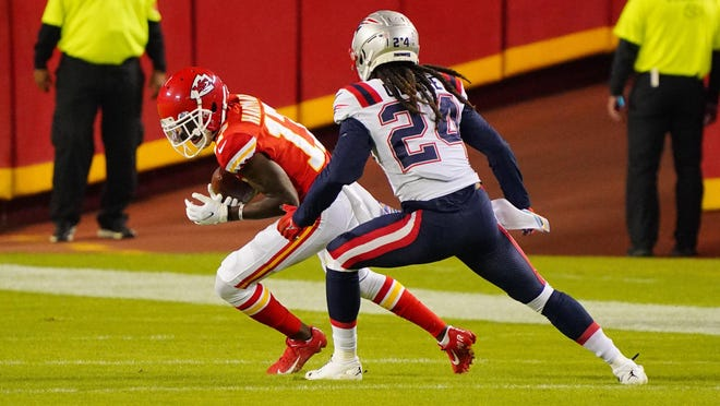 Patriots cornerback Stephn Gilmore -- who would test positive for COVID-19 a few days later -- defends Kansas City wide receiver Mecole Hardman during their Oct. 5 game.