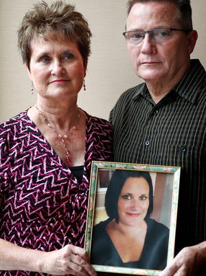 Julie and Daniel Rasmussen show a photo of their daughter, Niki Rasmussen, on Tuesday, June 27, 2018. Niki died from a fentanyl overdose in August 2017.