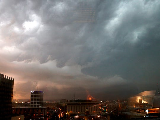 Storm clouds gather over downtown Tulsa, Okla., Wednesday night. The slow start to the nation's tornado season came to a blustery end Wednesday when tornadoes hit Arkansas and Oklahoma, including one that raked Tulsa and its suburbs during the evening rush hour.